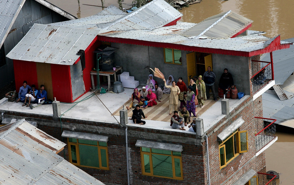 . In this handout photograph released by Ministry of Defense on September 10, 2014, stranded civilians wave from the rooftop of their home in the flood affected part of Srinagar.   AFP PHOTO/MINISTRY OF DEFENCE /AFP/Getty Images