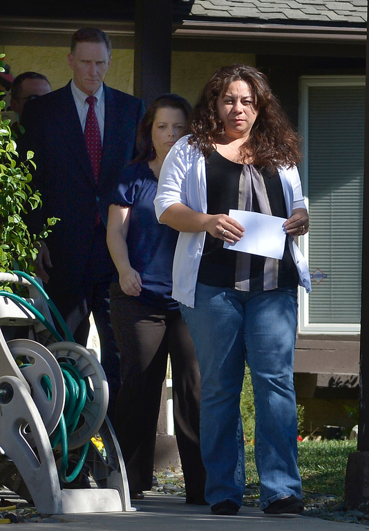 . Ana Hernandez walks out her front door followed by TSA Administrator John Pistole and friend Amy Sharp. Hernandez held a press conference on the front lawn of her home the day after her husband, TSA Behavior Detection Officer Gerardo Hernandez, was killed by a gunman in Terminal 3 at Los Angeles International Airport. Los Angeles, CA. 11/2/2013. photo by (John McCoy/Los Angeles Daily News)