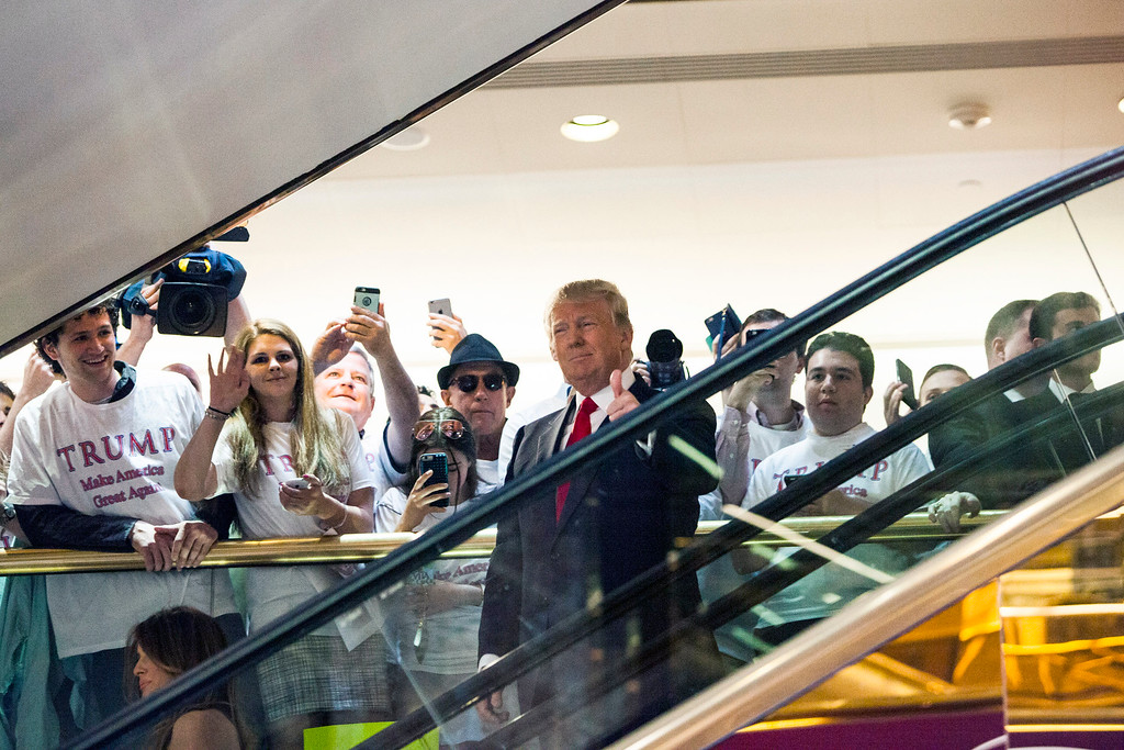 . Business mogul Donald Trump rides an escalator to a press event to announce his candidacy for the U.S. presidency at Trump Tower on June 16, 2015 in New York City.  Trump is the 12th Republican who has announced running for the White House.  (Photo by Christopher Gregory/Getty Images)
