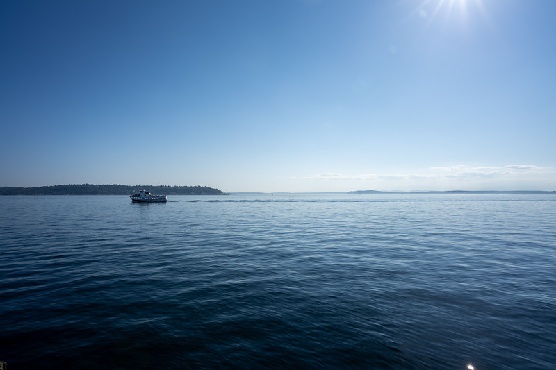 tour boat cutting across the puget sound in seattle washington