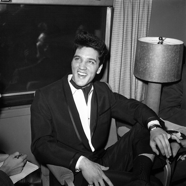 . Singer Elvis Presley smiles during a press conference inside his private railroad car at Los Angeles Union Station, California, United States as he arrived on April 20, 1960 to make a movie. (AP Photo/HPM)