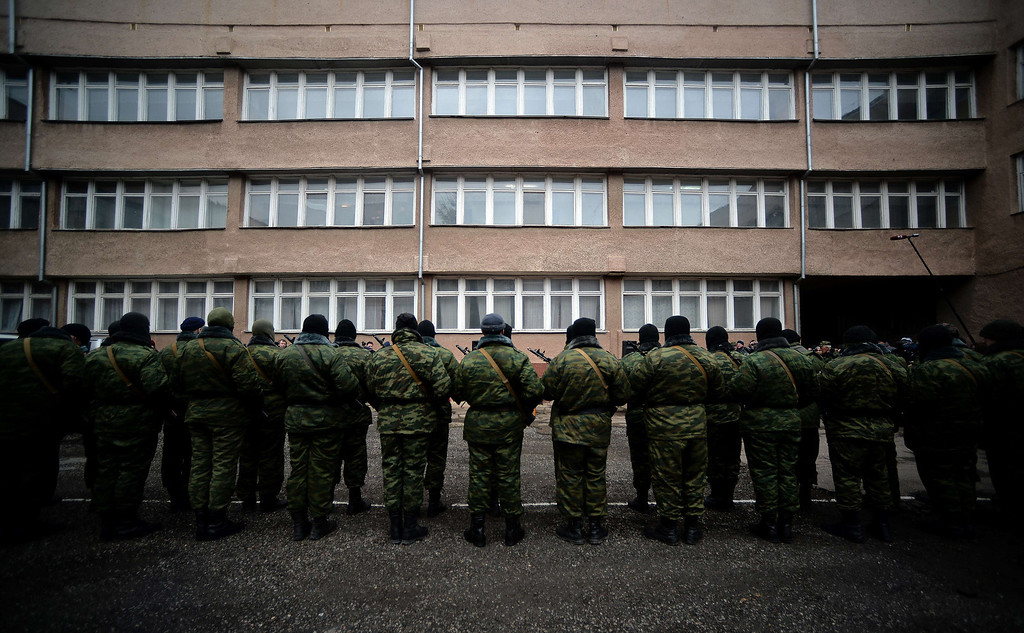 """. Pro-Russian forces dubbed the \""""military forces of the autonomous republic of Crimea\"""" stand before their swearing-in ceremony in the Republican military enlistment complex in Simferopol on March 10, 2014. Crimea\'s pro-Russian authorities sought to boost their claim to break from Ukraine Monday as volunteer soldiers swore an oath of allegiance in front of prime minister Sergei Aksyonov. He told journalists 186 volunteers had so far joined the new Crimean \""""self-defense\"""" units after pro-Moscow forces took power in the region and announced their intention to join with Russia, with a referendum planned for Sunday. MONTE FORTE/AFP/Getty Images"""