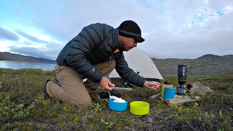 David Stock cooking while camping in Greenland