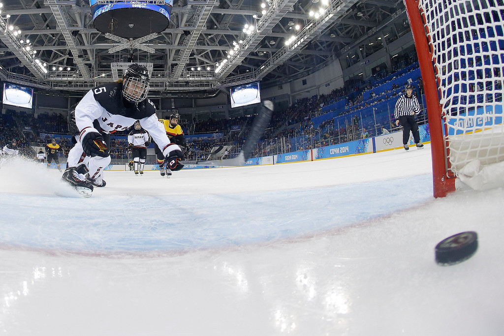 . Kanae Aoki of Japan races after the goal shot by Franziska Busch of Germany during the closing seconds of the women\'s ice hockey game at the 2014 Winter Olympics, Thursday, Feb. 13, 2014, in Sochi, Russia. Germany defeated Japan 4-0. (AP Photo/Brian Snyder, Pool)