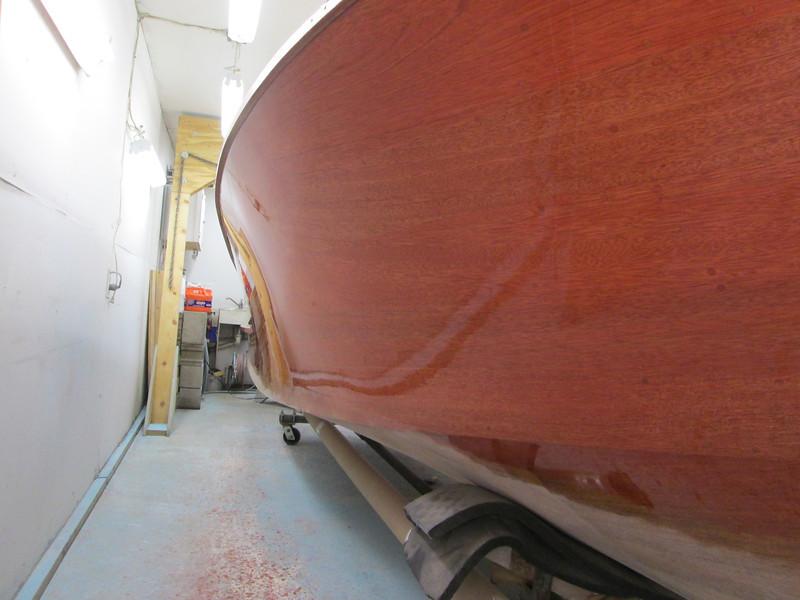 Port side with one coat of varnish over sealer.