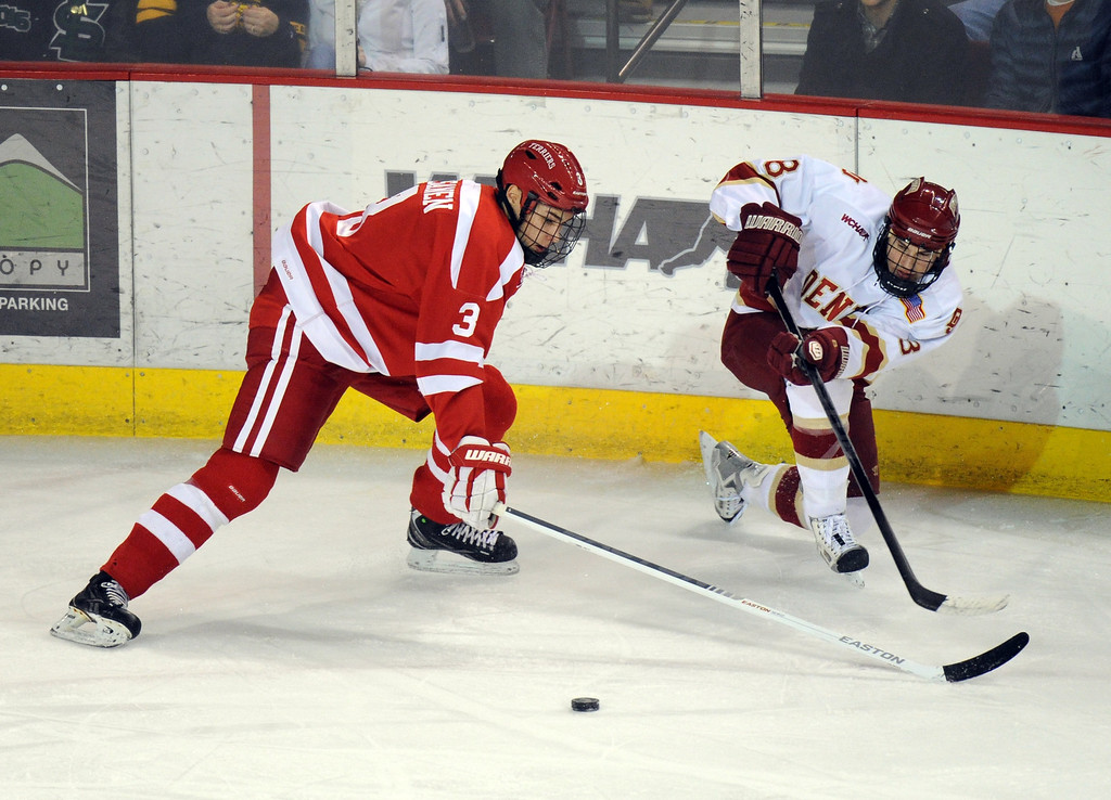 . University of Denver Nolan Zajac (8), right, controls the puck against  Boston University Ahti Oksanen (3) in the 1st period of the game at Magness Arena on in Denver on Saturday, Dec. 29, 2012. Hyoung Chang, The Denver Post