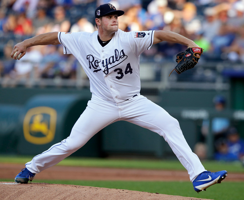 . Kansas City Royals starting pitcher Trevor Oaks delivers to a Cleveland Indians batter during the first inning of a baseball game at Kauffman Stadium in Kansas City, Mo., Wednesday, July 4, 2018. (AP Photo/Orlin Wagner)