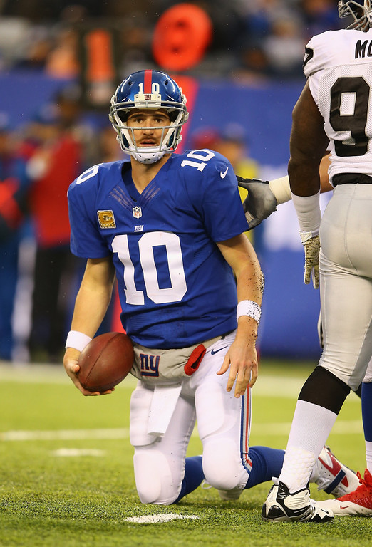 . Eli Manning #10 of the New York Giants looks on after falling to the ground against the Oakland Raiders during their game at MetLife Stadium on November 10, 2013 in East Rutherford, New Jersey.  (Photo by Al Bello/Getty Images)