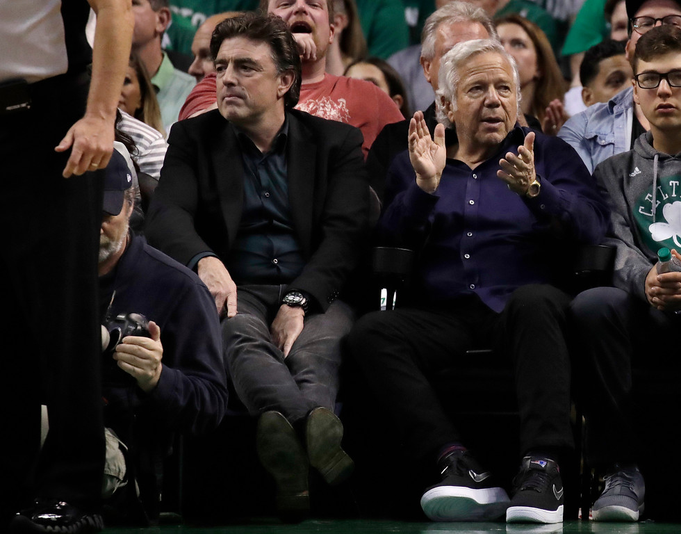 . Boston Celtics co-owner Wyc Grousbeck, left, and New England Patriots owner Robert Kraft, second from right, watch play during the second half of Game 2 of the NBA basketball Eastern Conference finals between the Celtics and the Cleveland Cavaliers, Friday, May 19, 2017, in Boston. (AP Photo/Elise Amendola)