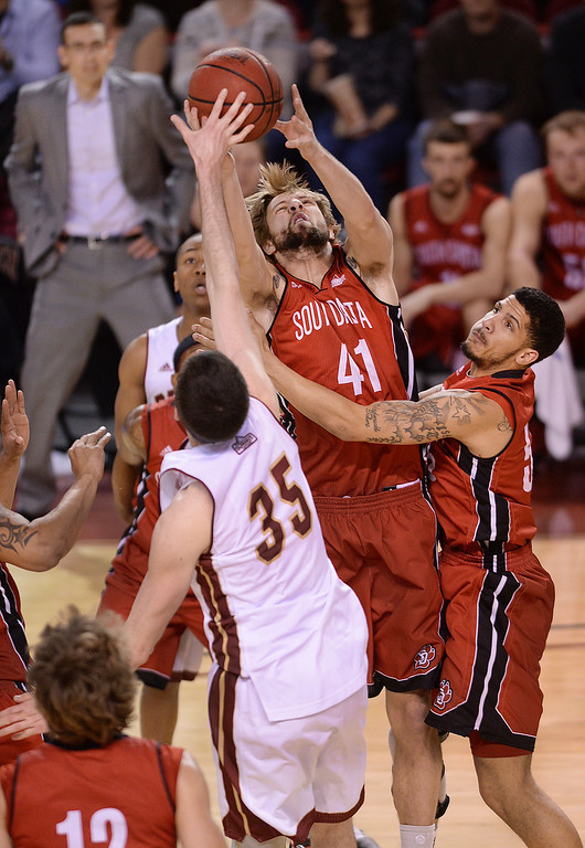 . DENVER, CO. - FEBRUARY 8, 2014: South Dakota sophomore forward Eric Robertson (41) fought for a rebound in the first half. The University of Denver hosted South Dakota Saturday afternoon, February 8, 2014. Photo By Karl Gehring/The Denver Post