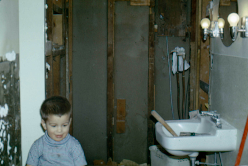 1969 - Bathroom remodel - tearing out the shower stall