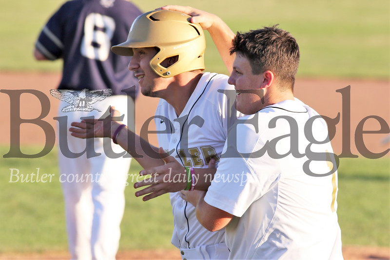 Bryan Presco shrugs in celebration with Braden Marcellus after his game-winning hit. Butler topped Freeport 4-3 with a come from behind win in the 7th inning. Seb Foltz/Butler Eagle