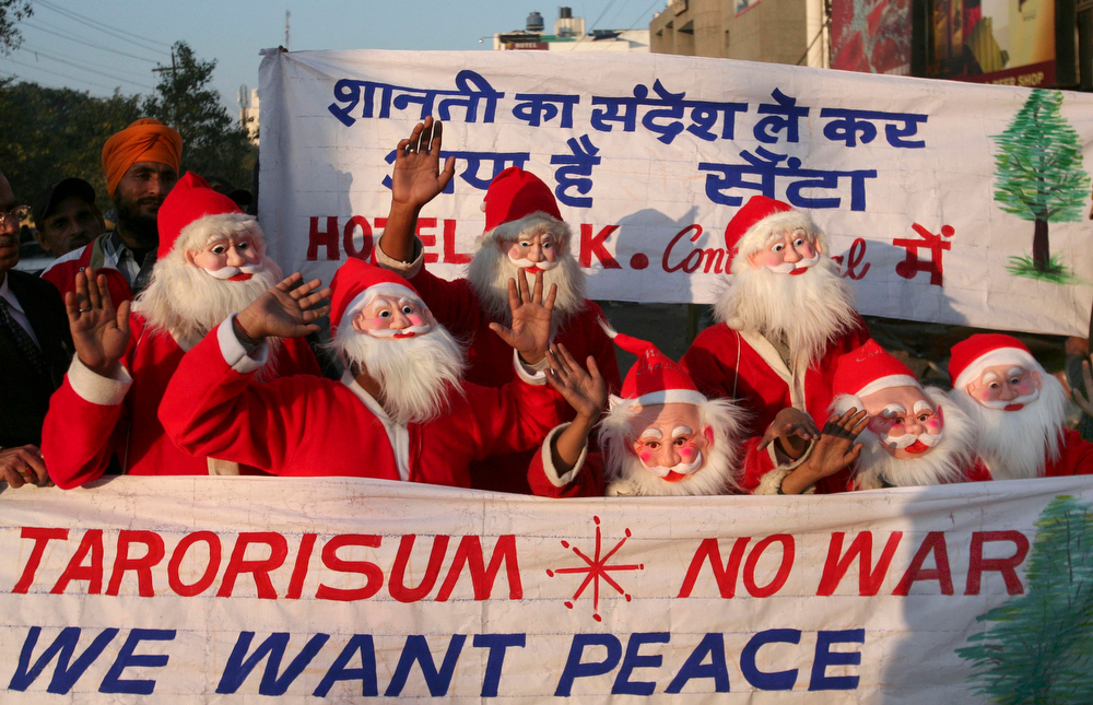 Description of . Children dressed as Santa Claus participate in a peace march on the eve of Christmas in Amritsar, India, Wednesday, Dec. 24, 2008. (AP Photo/Altaf Qadri)