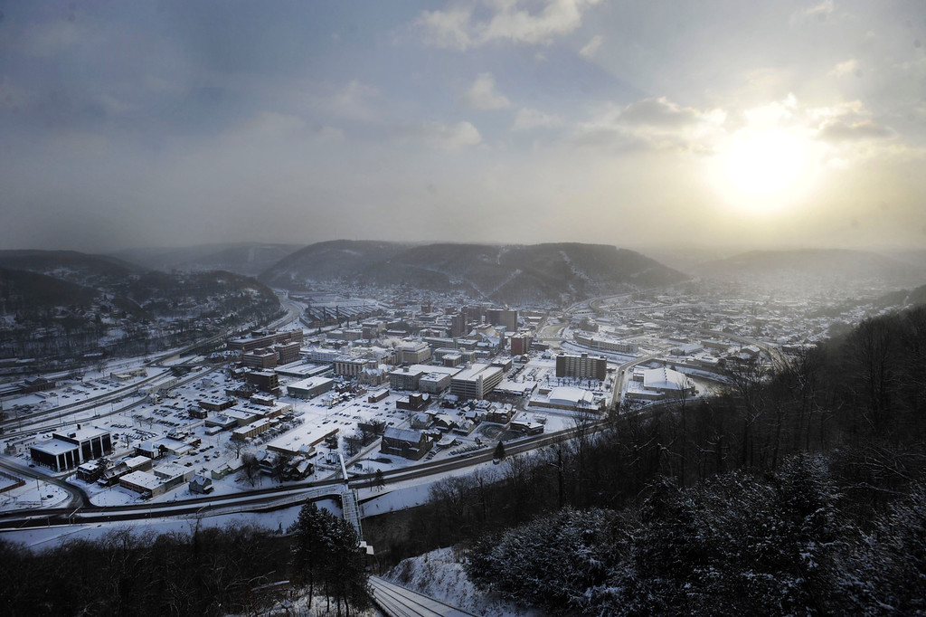 . A cold sun rises over the city of Johnstown, Pa. Tuesday Jan. 7, 2014.  The temperature was at minus 18 degrees at 8 a.m. (AP Photo/The Tribune-Democrat, Todd Berkey)