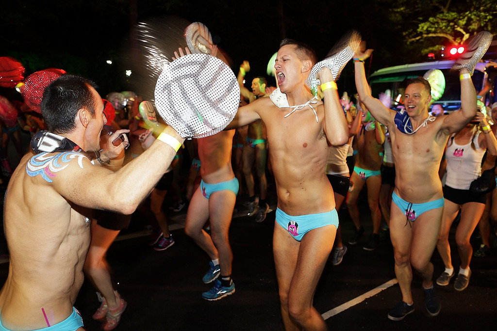 . Parade goers dance during the annual Sydney Gay and Lesbian Mardi Gras Parade on March 2, 2013 in Sydney, Australia. Thousands of spectators gathered to watch the 35th annual parade held in celebration of the gay, lesbian, bisexual and transgendered community.  (Photo by Brendon Thorne/Getty Images)