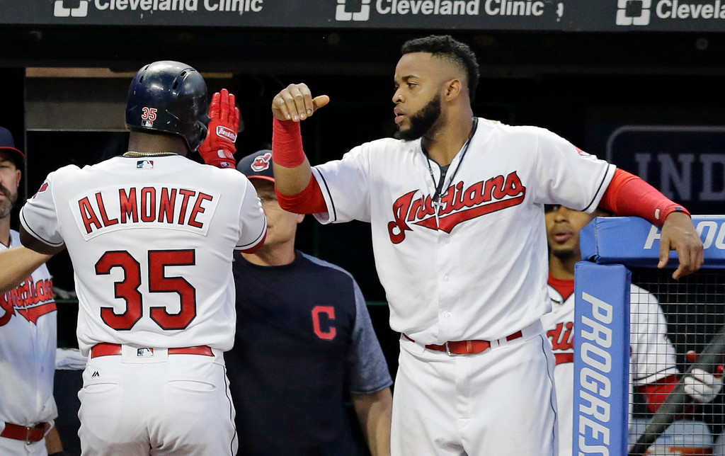 . Cleveland Indians\' Abraham Almonte, left, is congratulated by Carlos Santana after Almonte scored on an RBI-single by Erik Gonzalez in the fifth inning of a baseball game against the Toronto Blue Jays, Friday, July 21, 2017, in Cleveland. (AP Photo/Tony Dejak)