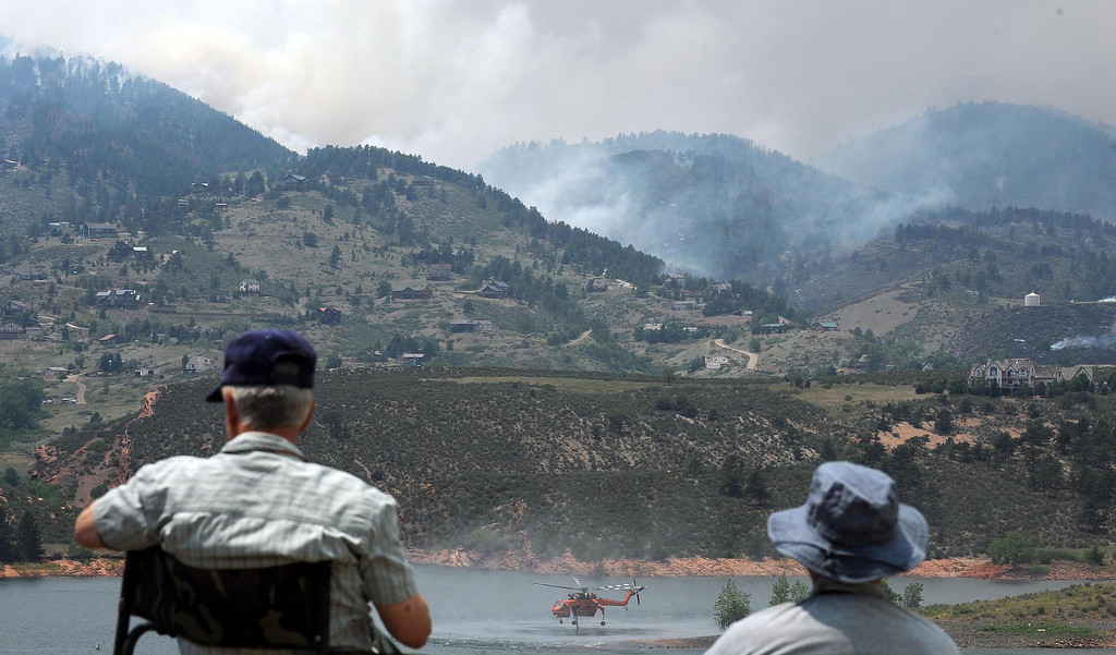 . LARIMER CO. - Evacuees of the High Park Fire view firefighting efforts from across Horsetooth Reservoir Monday afternoon. Steve Nehf, The Denver Post