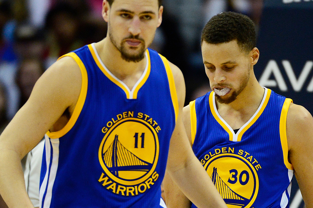. DENVER, CO - JANUARY 13: Klay Thompson (11) and Stephen Curry (30) of the Golden State Warriors reset after a foul during the first half at the Pepsi Center on January 13, 2016 in Denver, Colorado.  (Photo by Brent Lewis/The Denver Post)