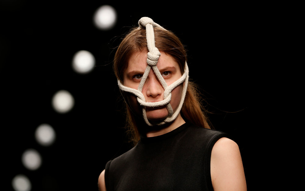 Description of . A model presents a creation from the Central Saint Martins Autumn/Winter 2013 collection during London Fashion Week, February 15, 2013. REUTERS/Eddie Keogh