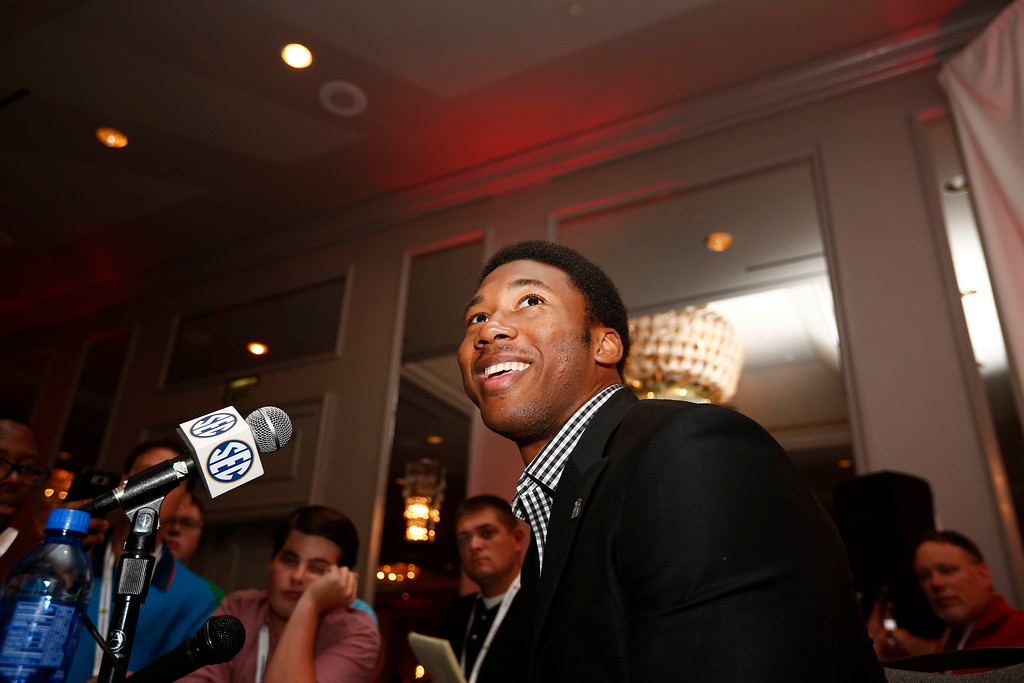 . Texas A&M defensive linebacker Myles Garrett speaks to the media at the Southeastern Conference NCAA college football media days, Tuesday, July 12, 2016, in Hoover, Ala. (AP Photo/Brynn Anderson)