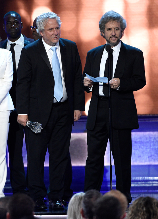 """. Larry Karaszewski, left, and Scott Alexander accept the award for best movie made for television or limited series for \""""The People v. O.J. Simpson: American Crime Story\"""" at the 22nd annual Critics\' Choice Awards at the Barker Hangar on Sunday, Dec. 11, 2016, in Santa Monica, Calif. (Photo by Chris Pizzello/Invision/AP)"""