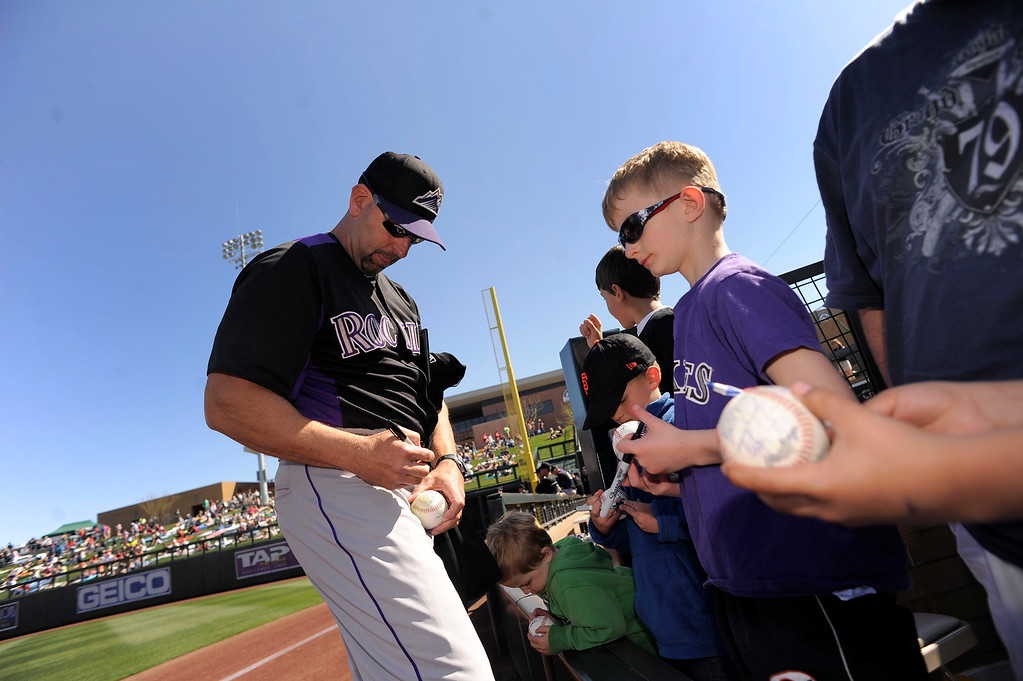 . SCOTTSDALE, AZ. - FEBRUARY 23: Manager Walt Weiss (22) of the Colorado Rockies signs autographs before their game against the Arizona Diamondbacks February 23, 2013 in Scottsdale. (Photo By John Leyba/The Denver Post)