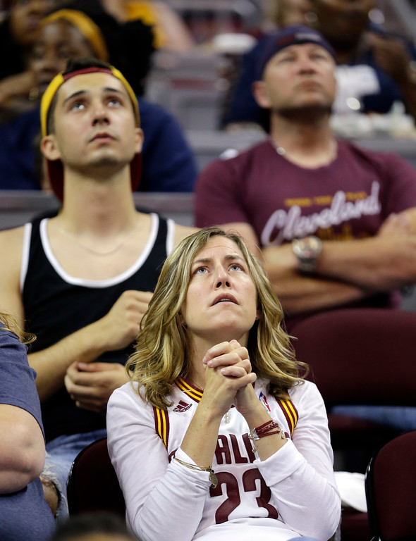 . Melissa Filipowicz watches during a watch party at Quicken Loans Arena during Game 5 of basketball\'s NBA Finals between the Golden State Warriors and the Cleveland Cavaliers, Monday, June 12, 2017, in Cleveland. (AP Photo/Tony Dejak)