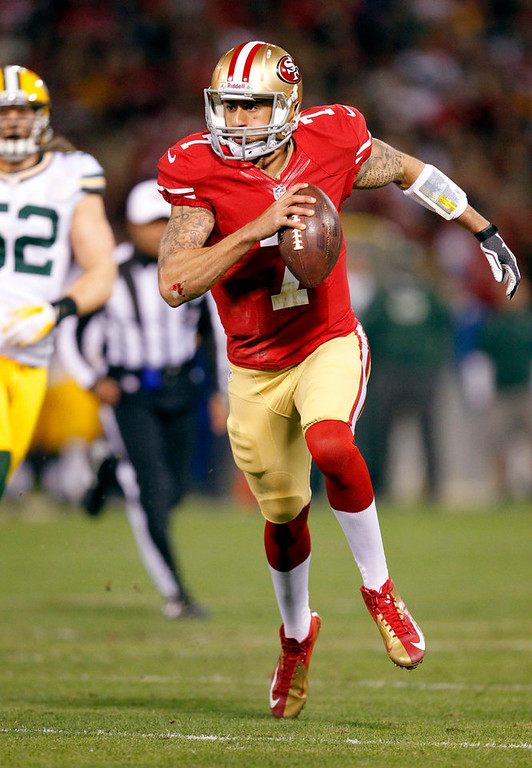 . San Francisco 49ers quarterback Colin Kaepernick (7) runs for a 20-yard touchdown against the Green Bay Packers during the first quarter of an NFC divisional playoff NFL football game in San Francisco, Saturday, Jan. 12, 2013. (AP Photo/Tony Avelar)