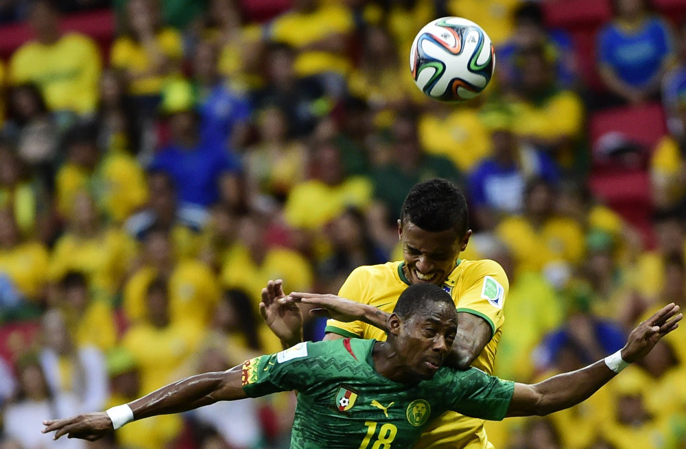 . Cameroon\'s midfielder Enoh Eyong (foreground) vies with Brazil\'s midfielder Luiz Gustavo during a Group A football match between Cameroon and Brazil at the Mane Garrincha National Stadium in Brasilia during the 2014 FIFA World Cup on June 23, 2014.     PIERRE-PHILIPPE MARCOU/AFP/Getty Images