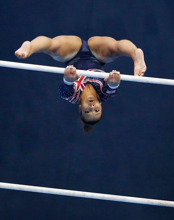 . Great Britain\'s Rebecca Downie competes on the uneven bars during the women\'s apparatus finals at the European Men\'s and Women\'s Artistic Gymnastic individual Championships in Moscow April 20, 2013.  REUTERS/Grigory Dukor