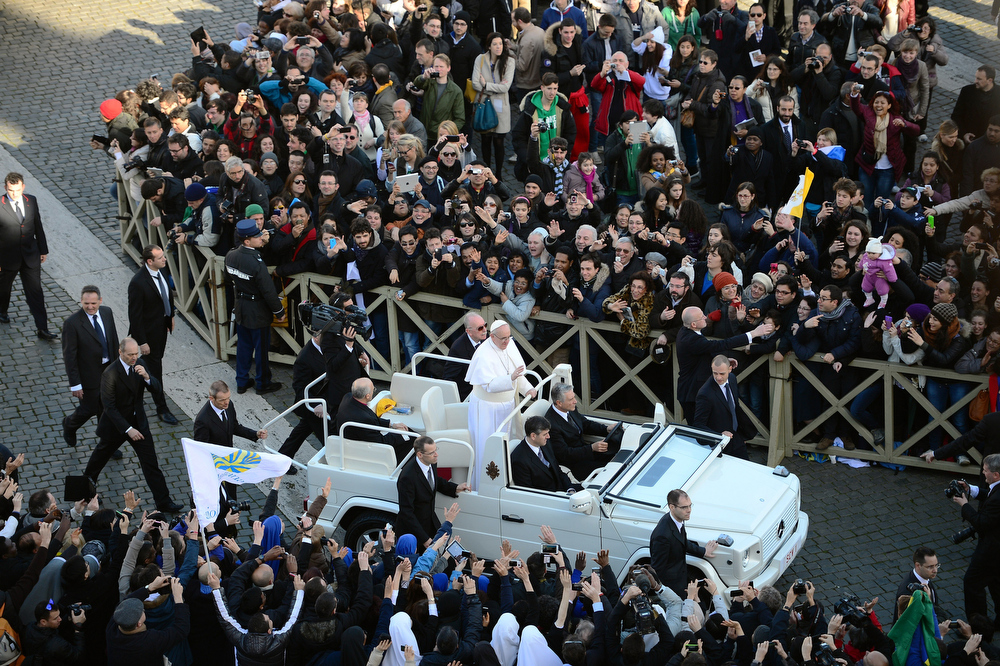 . Pope Francis makes his way around St Peter�s Square on March 19, 2013 in Vatican City, Vatican. The inauguration of Pope Francis is being held in front of an expected crowd of up to one million pilgrims and faithful who have crowded into St Peter\'s Square and the surrounding streets to see the former Cardinal of Buenos Aires officially take up his position. Pope Francis\' inauguration takes place in front his cardinals, spiritual leaders as well as heads of states from around the world and he will now lead an estimated 1.3 billion Catholics.  (Photo by Jeff J Mitchell/Getty Images)