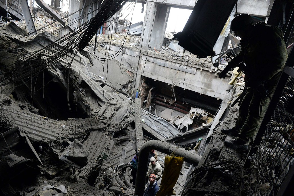 . Ukrainian prisoners of war and emergency workers work in the ruins, extracting from the rubble the bodies of dead Ukrainian soldiers inside a destroyed airport building in the eastern Ukrainian city of Donetsk, on February 26, 2015. Ukraine\'s military said Thursday it was starting the withdrawal of heavy weapons from the frontline with pro-Russian rebels, a key step in a stuttering peace plan. The start of the withdrawal by Kiev comes after a shaky truce that was meant to come into force February 15 finally took hold across the Ukraine conflict zone in recent days. VASILY MAXIMOV/AFP/Getty Images