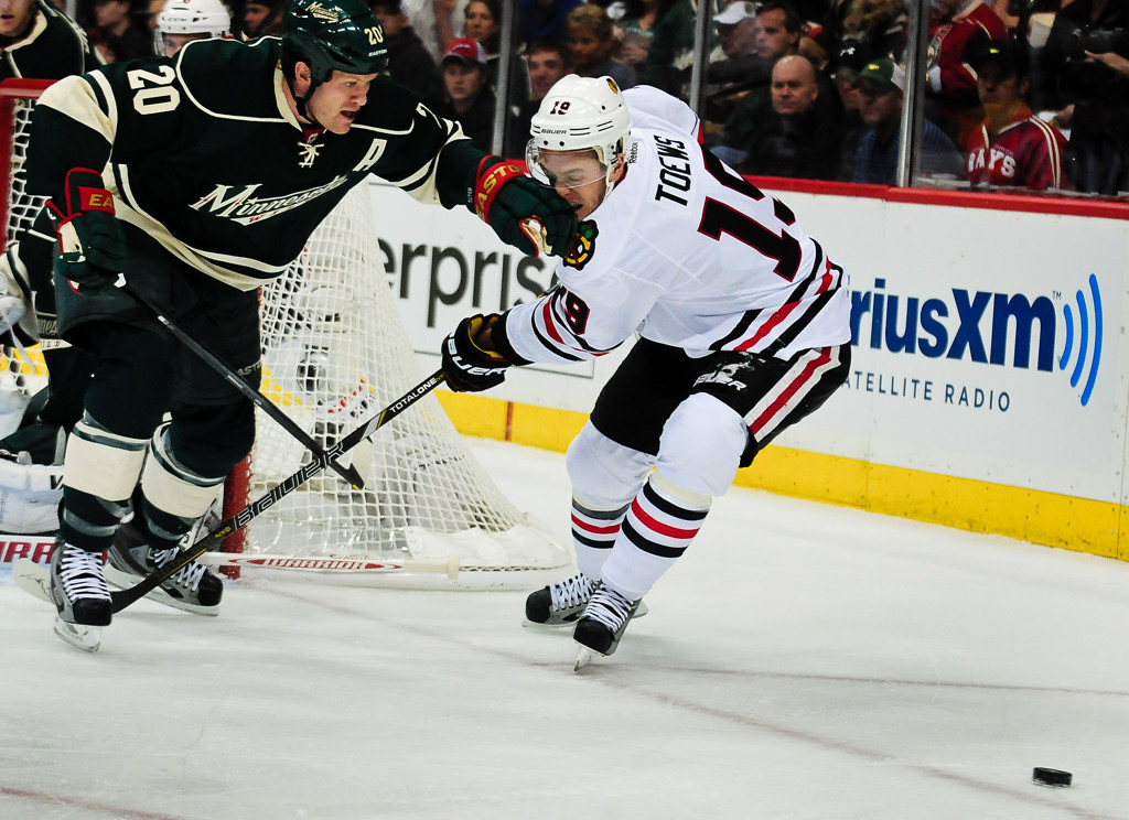 . Chicago center Jonathan Toews, right, gets a face full of Minnesota defenseman Ryan Suter in the first period. (Pioneer Press: Ben Garvin)