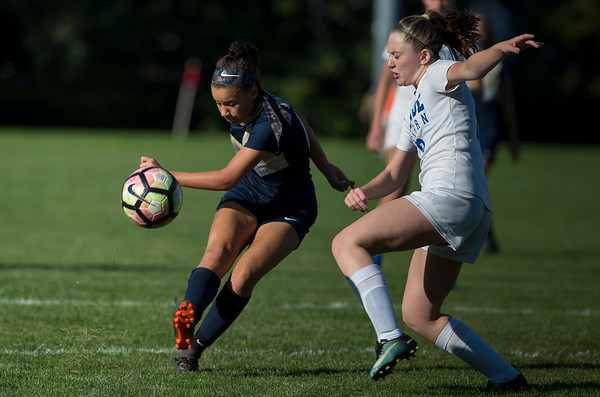 09/17/19 Wesley Bunnell | StaffrrBristol Eastern vs Newington soccer on Tuesday afternoon at Newington High School. Newington's Olivia Mullings (15) and Eastern's Leah Policarpio (12).
