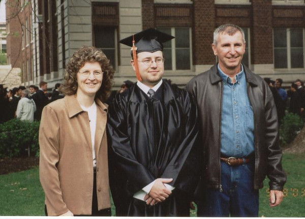 Chuck_with_his_Mom_and_Dad_Graduation_03.jpg