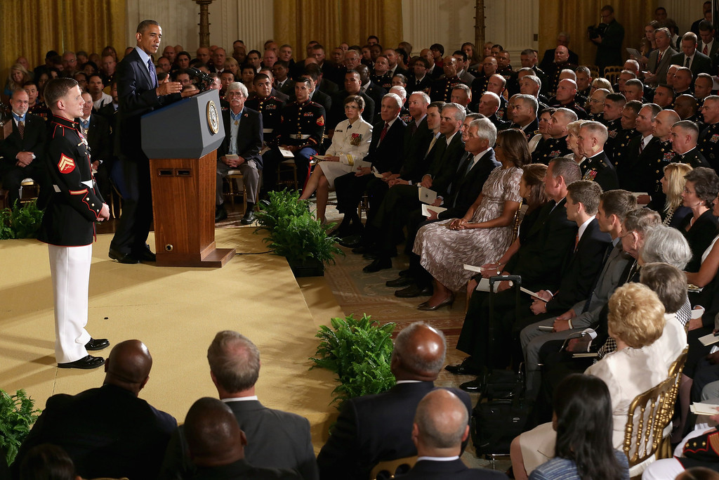. U.S. President Barack Obama delivers remarks before awarding retired Marine Cpl. William \'Kyle\' Carpenter with the Medal of Honor during a ceremony in the East Room of the White House on June 19, 2014 in Washington, DC.  (Photo by Chip Somodevilla/Getty Images)
