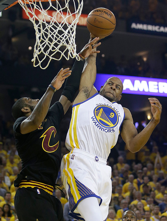 . Golden State Warriors forward Andre Iguodala (9) shoots against Cleveland Cavaliers guard Kyrie Irving during the first half of Game 5 of basketball\'s NBA Finals in Oakland, Calif., Monday, June 13, 2016. (AP Photo/Marcio Jose Sanchez)