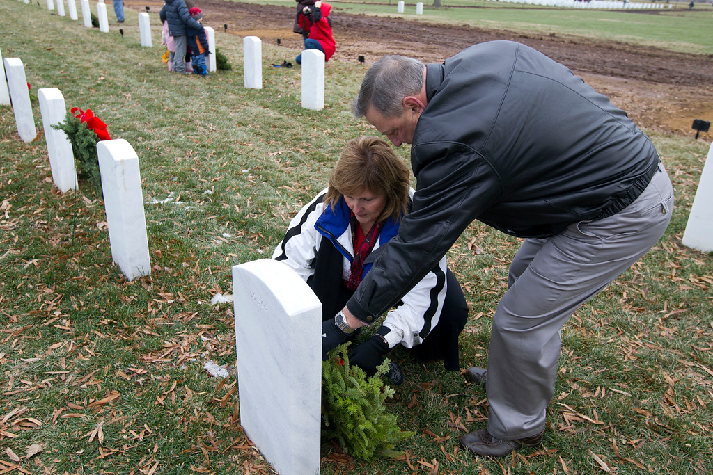 . Gov. Paul LePage of Maine and his wife Ann, lay a holiday wreath at the grave of a soldier at Arlington National Cemetery in Arlington, Va., Saturday Dec. 14, 2013, during Wreaths Across America Day. Wreaths Across America was started in 1992 at Arlington National Cemetery by Maine businessman Morrill Worcester and has expanded to hundreds of veterans\' cemeteries and other locations in all 50 states and beyond. (AP Photo/Jose Luis Magana)