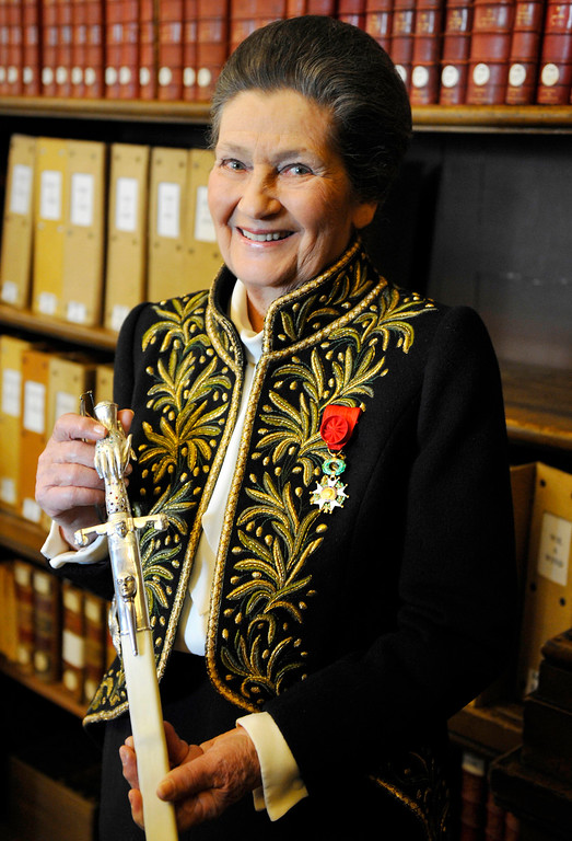 . FILE - In this March 18, 2010 file photo, Simone Veil, dressed in the French Academician\'s uniform, displays her ceremonial epee in the library of the Institut de France before a ceremony in Paris. Simone Veil, a Nazi death camp survivor and prominent French politician who spearheaded abortion rights, died June 30 at age 89. (Philippe Wopjazer, Pool photo via AP, File)