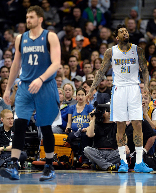 . Wilson Chandler (21) of the Denver Nuggets reacts to being called for a foul on Kevin Love (42) of the Minnesota Timberwolves during the second quarter at the Pepsi Center on Monday, March 3, 2014. (Photo By AAron Ontiveroz/The Denver Post)