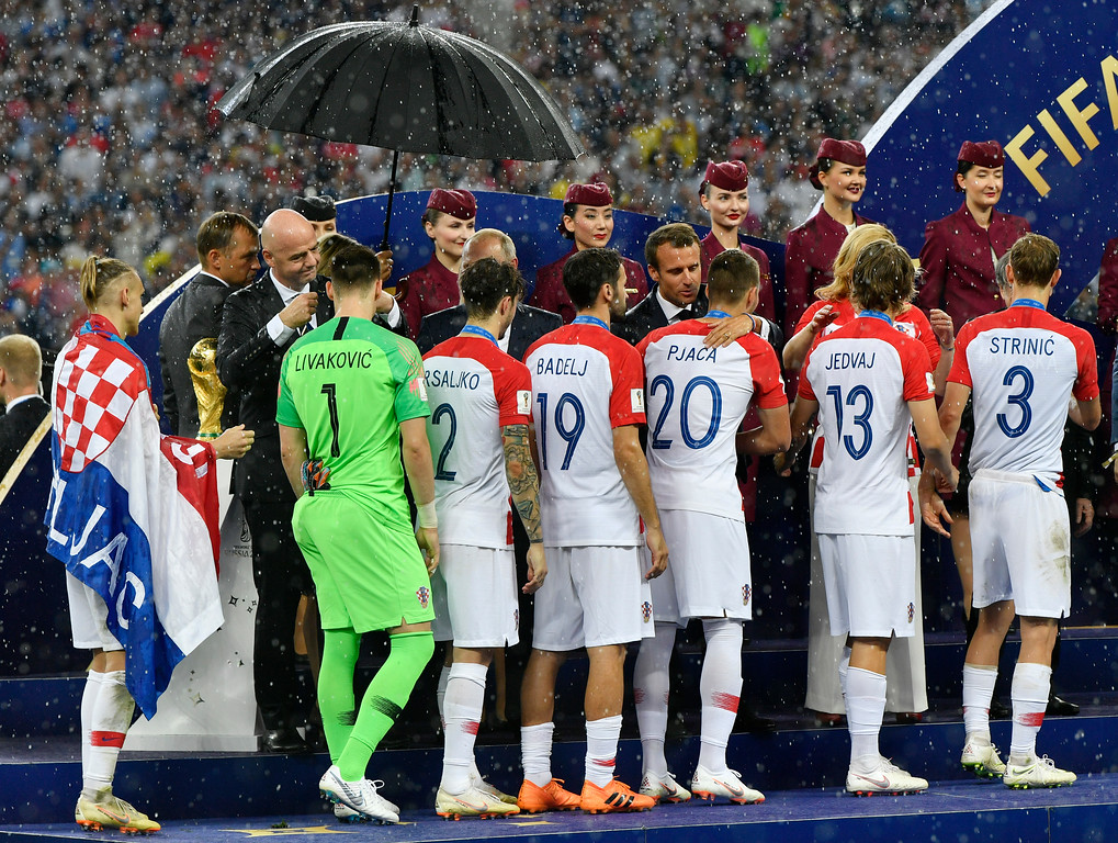 . Croatian players walk past the trophy when they get their silver medals after losing the final match between France and Croatia at the 2018 soccer World Cup in the Luzhniki Stadium in Moscow, Russia, Sunday, July 15, 2018. (AP Photo/Martin Meissner)