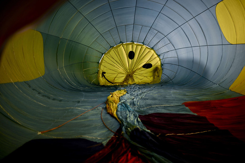 . Balloonists inflate a balloon with decorated with a smile during the 18th International Festival of Hot Air Balloons in Alter do Chao in the center of Portugal on November 10 2014. PATRICIA DE MELO MOREIRA/AFP/Getty Images