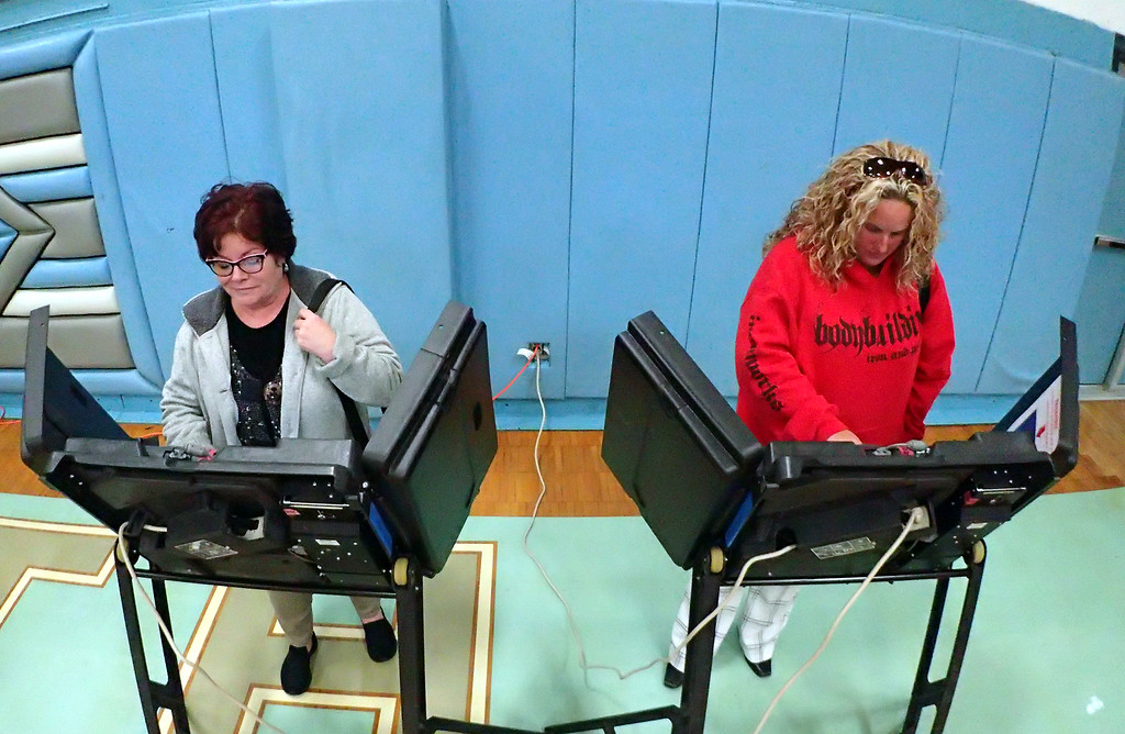 . Jonathan Tressler � The News-Herald <br> Vicky Geer, left, and Tara Namestnik cast their ballots Nov. 7 at Willoughby South High School.