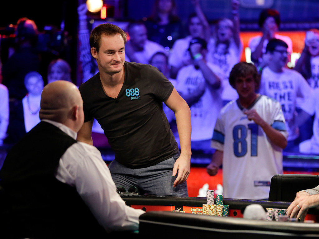 . Michiel Brummelhuis of the Netherlands, left, stands up from the table after being eliminated during the World Series of Poker Final Table, Monday, Nov. 4, 2013, in Las Vegas. (AP Photo/Julie Jacobson)
