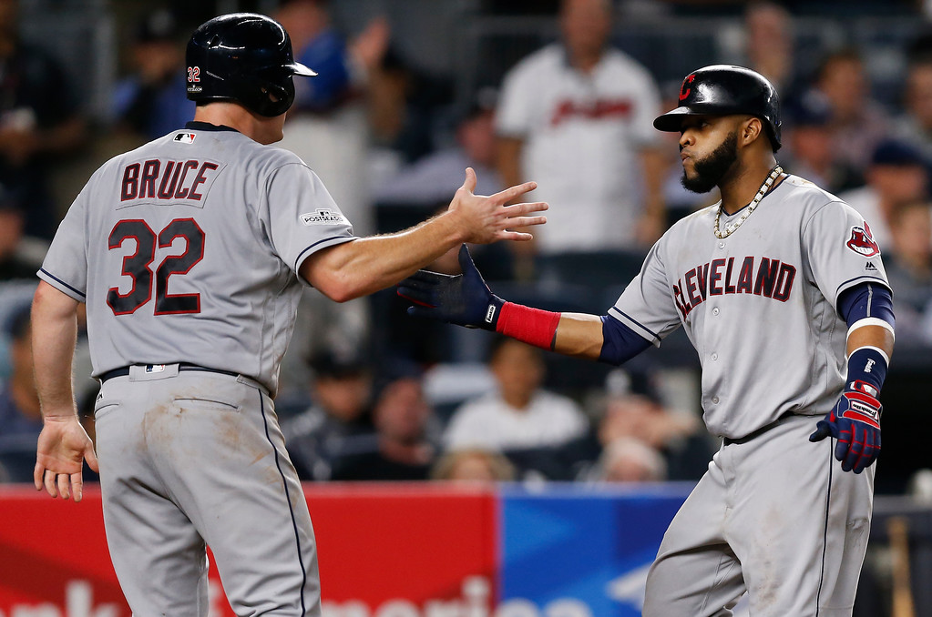 . Cleveland Indians\' Jay Bruce (32) congratulates Carlos Santana after Santana hit a two-run home run against the New York Yankees during the fourth inning in Game 4 of baseball\'s American League Division Series, Monday, Oct. 9, 2017, in New York. (AP Photo/Kathy Willens)