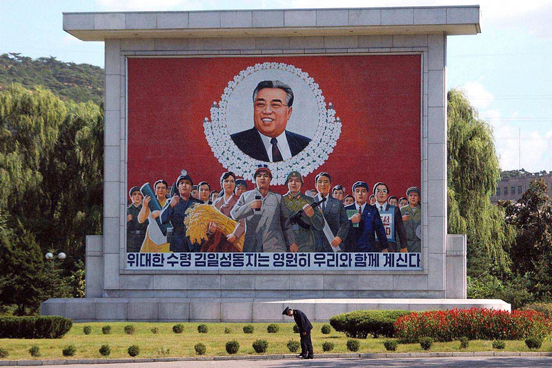 . A soldier stands in front of a portrait of former North Korean leader Kim Il Sung September 16, 2002 in Pyongyang, North Korea. The country recently hosted a historic visit from Japanese Prime Minister Junichiro Koizumi who spoke with North Korean leader Kim Jong-il about normalizing diplomatic relations between the countries.  (Japan Pool/Getty Images)