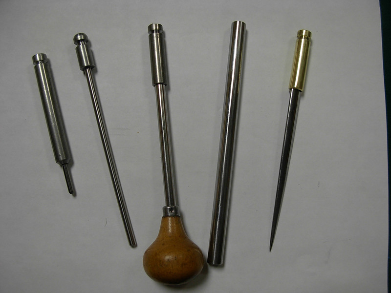 Various burnishers that can be used,  small one on the left is a high polished 1/8 inch carbide drill shank. It is very useful for burnishing the face of the blade prior to burnishing the burr or for removing a burr in preparation for re turning a new burr.  The center burnisher is installed in a 1/4 inch adapter and can be removed to receive any 1/4 inch rod. Custom adapters can be special ordered to fit your burnisher of choice. Kinda like Burger King. One of the cheapist burnishers I have ever found is the lower 8 inches above the head on a  golf club iron shank, they are smooth and hard and hold up well.. The current plan is to include the 1/8 carbide burnisher and one 1/4 inch HSS burnisher with the system.