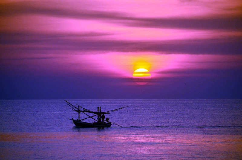 Seascape with fishing boat, Thailand.