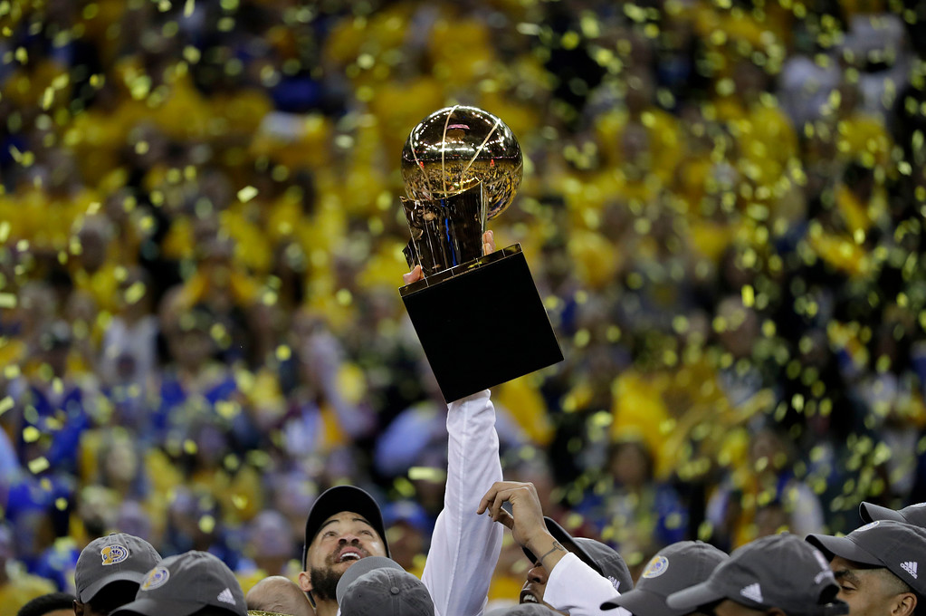 . Golden State Warriors center JaVale McGee holds up the Larry O\'Brien NBA Championship Trophy after Game 5 of basketball\'s NBA Finals between the Warriors and the Cleveland Cavaliers in Oakland, Calif., Monday, June 12, 2017. The Warriors won 129-120 to win the NBA championship. (AP Photo/Marcio Jose Sanchez)