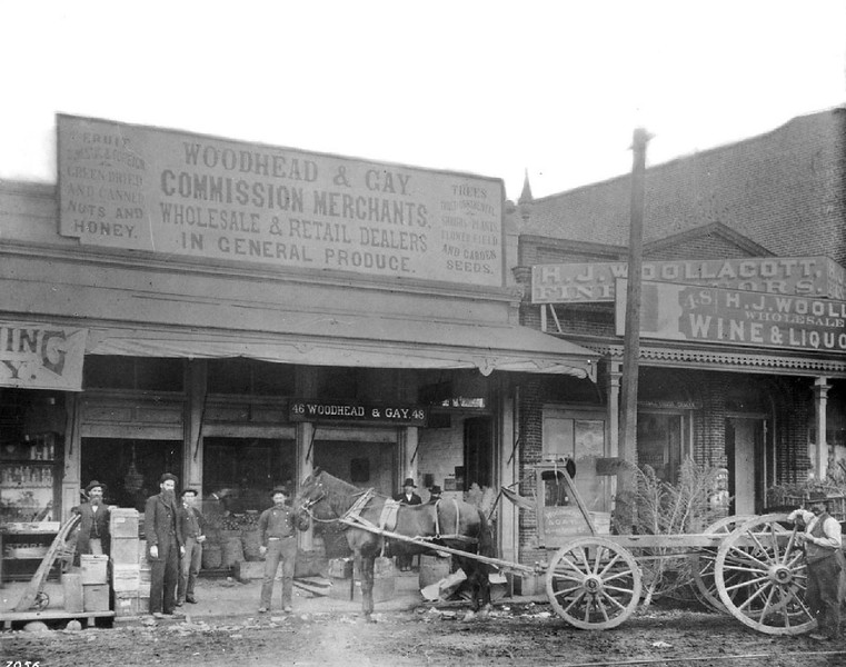 Portrait of men standing outside the Woodhead and Gay Store, Los Angeles, ca.1880